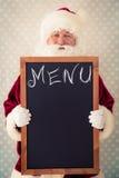 Santa Claus holding blackboard Royalty Free Stock Photography