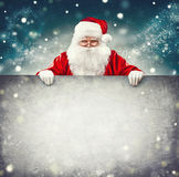 Santa Claus holding blank advertisement banner. Background with copy space for text Royalty Free Stock Image