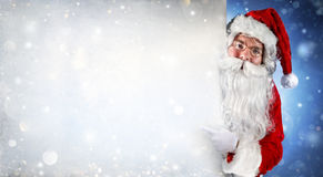 Santa Claus Holding Blank Banner. And Pointing With His Finger Royalty Free Stock Image
