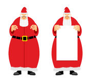 Santa Claus holding blank. Grandfather with a grey beard, fairyt. Ale character who brings gifts to children at Christmas Royalty Free Stock Images