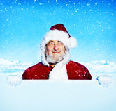 Santa Claus Holding a Blank Sign Snowing Concept Stock Image