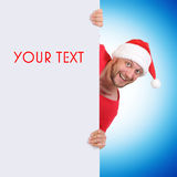 Santa Claus holding a blank for your text or image Royalty Free Stock Image