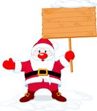 Santa Claus holding board sign Stock Image