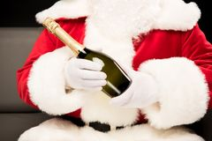 Santa Claus holding bottle of champagne Royalty Free Stock Photo