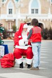 Santa Claus Holding Boy's Hands Royalty Free Stock Photo
