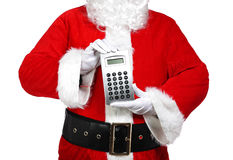Santa Claus holding a calculator Royalty Free Stock Images