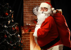 Santa Claus holding carrying sack with gifts Stock Photography