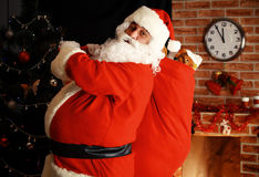Santa Claus holding carrying sack with gifts Royalty Free Stock Photography