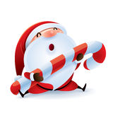 Santa Claus holding Christmas candy.  Stock Image