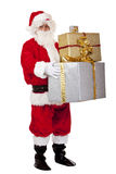 Santa Claus holding Christmas gift boxes Stock Images