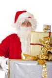 Santa Claus holding Christmas gift boxes in hands Royalty Free Stock Images