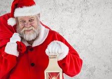 Santa claus holding a christmas lantern and gift bag Royalty Free Stock Photo