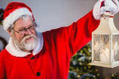 Santa Claus holding Christmas lantern stock photos