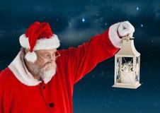 Santa claus holding christmas lantern Royalty Free Stock Photography