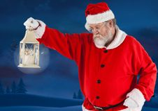 Santa claus holding a christmas lantern Royalty Free Stock Photos
