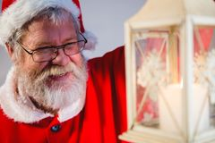 Santa Claus holding Christmas lantern Royalty Free Stock Images