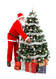 Santa Claus holding Christmas tree Royalty Free Stock Image