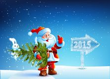Santa Claus holding a Christmas tree in their hands Royalty Free Stock Images