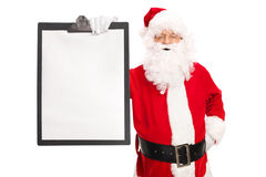 Santa Claus holding a clipboard with a blank paper Stock Photos
