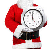 Santa Claus holding a clock Royalty Free Stock Photos