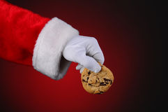 Santa Claus Holding Cookie Stock Photo