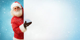 Santa Claus holding copyspace blank sign for Your Text Stock Photos