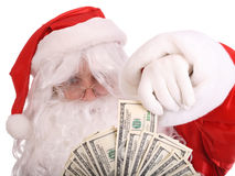 Santa Claus holding dollar banknote. Royalty Free Stock Images
