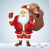 Santa Claus Holding eine Zuckerstangesüßigkeit und mit einer Tasche von Geschenken im vorderen Winterhintergrund Auch im corel ab Lizenzfreies Stockfoto