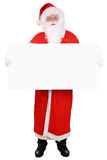 Santa Claus holding empty banner on Christmas isolated Stock Image