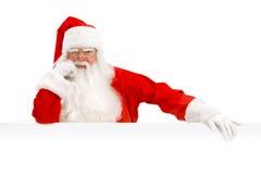 Santa Claus Holding ett advertizingutrymme Royaltyfri Foto