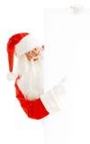 Santa Claus Holding ett advertizingutrymme Arkivbilder