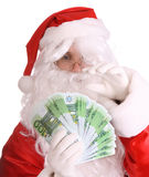 Santa Claus holding euro banknote. Isolated Stock Photos