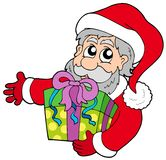 Santa Claus holding gift Stock Image