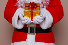 Santa Claus holding a gift Stock Image