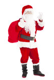 Santa Claus holding gift bag with ok gesture Royalty Free Stock Photo