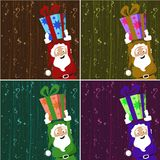 Santa claus holding gift box Stock Images