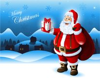 Santa Claus holding a gift box Stock Images