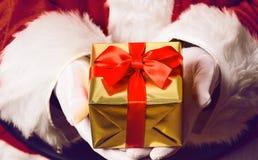 Santa Claus holding gift Stock Photo