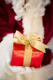 Santa Claus holding gift box Royalty Free Stock Image