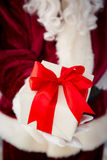 Santa Claus holding gift box Stock Photography