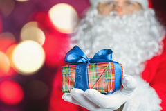 Santa Claus holding gift box or present at Christmas Royalty Free Stock Photography
