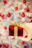 Santa Claus holding gift box Stock Photos