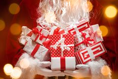 Santa Claus holding gift boxes Royalty Free Stock Photos