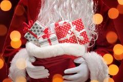 Santa Claus holding gift boxes Royalty Free Stock Photo