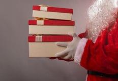Santa Claus holding gift boxes. Santa Claus holding some gift boxes Stock Photos