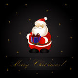 Santa Claus Holding Gift Royalty Free Stock Photo
