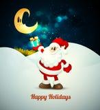 Santa Claus Holding Gift nell'ambito di luce della luna Fotografia Stock
