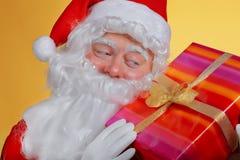 Santa Claus holding a  gift Stock Photos