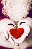 Santa Claus holding gift Royalty Free Stock Photo