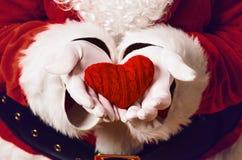 Santa Claus holding gift Royalty Free Stock Photos